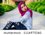 muslim young woman wearing dark ... | Shutterstock . vector #1116975260