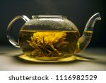 teapot and glass cup with... | Shutterstock . vector #1116982529