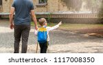 back to school. parent taking... | Shutterstock . vector #1117008350