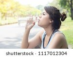 young charming woman drinking... | Shutterstock . vector #1117012304