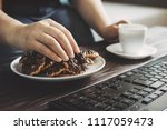 unhealthy snack at work time....   Shutterstock . vector #1117059473