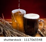 two glasses brown and golden... | Shutterstock . vector #1117065548