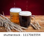 two glasses brown and golden... | Shutterstock . vector #1117065554