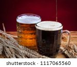 two glasses brown and golden... | Shutterstock . vector #1117065560