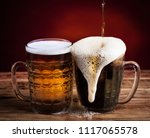 two glasses brown and golden... | Shutterstock . vector #1117065578