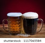 two glasses brown and golden... | Shutterstock . vector #1117065584