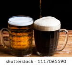 two glasses brown and golden... | Shutterstock . vector #1117065590