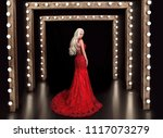 beautiful blond woman in red...   Shutterstock . vector #1117073279
