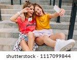 smiling dark haired girl making ... | Shutterstock . vector #1117099844