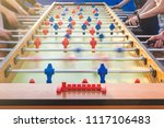 people playing table football... | Shutterstock . vector #1117106483