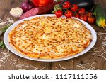 tasty four cheese pizza    Shutterstock . vector #1117111556