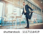 worker in suit stretching leg... | Shutterstock . vector #1117116419