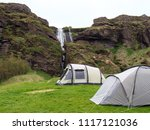 camping tents near waterfall ... | Shutterstock . vector #1117121036