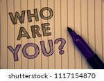 Small photo of Conceptual hand writing showing Who Are You Question. Business photos showcasing Introduce or Identify Yourself Tell your Personal Story