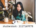 beautiful asian woman sitting... | Shutterstock . vector #1117169978