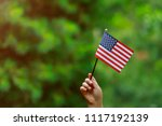 With American Flag In Her Hand...