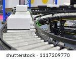 cardboard boxes on conveyor... | Shutterstock . vector #1117209770
