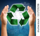 Recycling symbol on a woman hand - stock photo