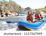Little children kayaking on river. Summer camp - stock photo