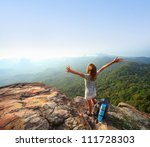 young backpacker standing on...   Shutterstock . vector #111728303