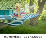 young freelancer sitting in...   Shutterstock . vector #1117320998
