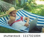 young male freelancer working...   Shutterstock . vector #1117321004