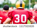 american football players in... | Shutterstock . vector #1117323320