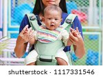 close up mother carrying her... | Shutterstock . vector #1117331546