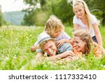 happy family laughs together... | Shutterstock . vector #1117332410