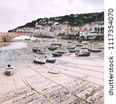 fishing boats  at low tide  in... | Shutterstock . vector #1117354070
