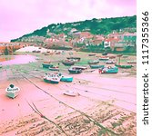 fishing boats  at low tide  in... | Shutterstock . vector #1117355366