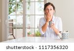 middle aged woman drinking a... | Shutterstock . vector #1117356320