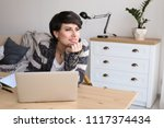 young woman working with laptop ...   Shutterstock . vector #1117374434