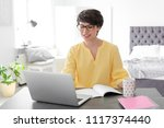 young woman working with laptop ...   Shutterstock . vector #1117374440