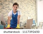 young man in apron and gloves... | Shutterstock . vector #1117392650