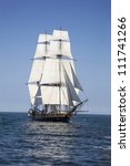 Tall Ship Sailing On Blue Waters