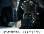 criminal man with handcuffs in... | Shutterstock . vector #1117417790