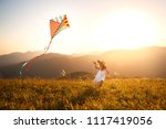 happy child girl running with a ... | Shutterstock . vector #1117419056