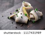 Stock photo classic marinated herring rolls with chives and lemon 1117431989