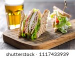 club sandwich served with beer | Shutterstock . vector #1117433939