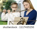 schoolgirl plays flute as an...