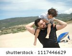 father and son playing in the... | Shutterstock . vector #1117446629