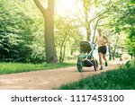 running woman with baby... | Shutterstock . vector #1117453100