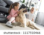 happy adorable kids petting... | Shutterstock . vector #1117510466