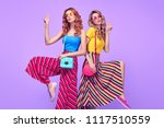 two girls fooling around in... | Shutterstock . vector #1117510559
