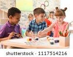 cute little children painting...   Shutterstock . vector #1117514216