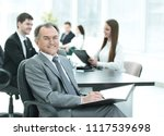 senior businessman with a... | Shutterstock . vector #1117539698