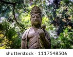 Buddha Statue In Front Of...