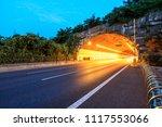highway road tunnel at night...   Shutterstock . vector #1117553066