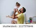 father and daughter playing on...   Shutterstock . vector #1117570646